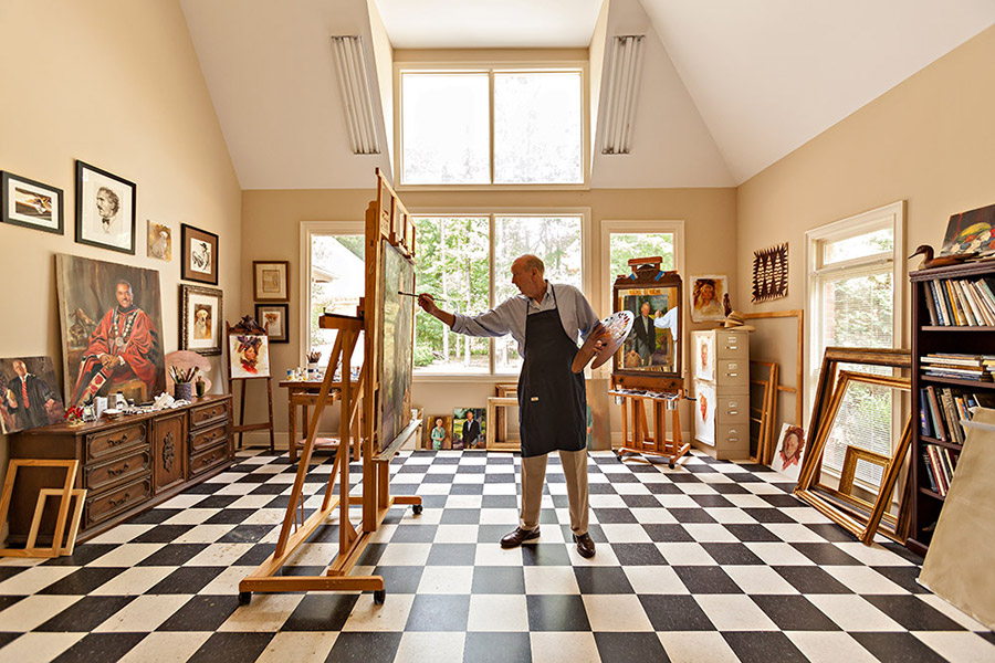 Jamie painting a portriat in his studio